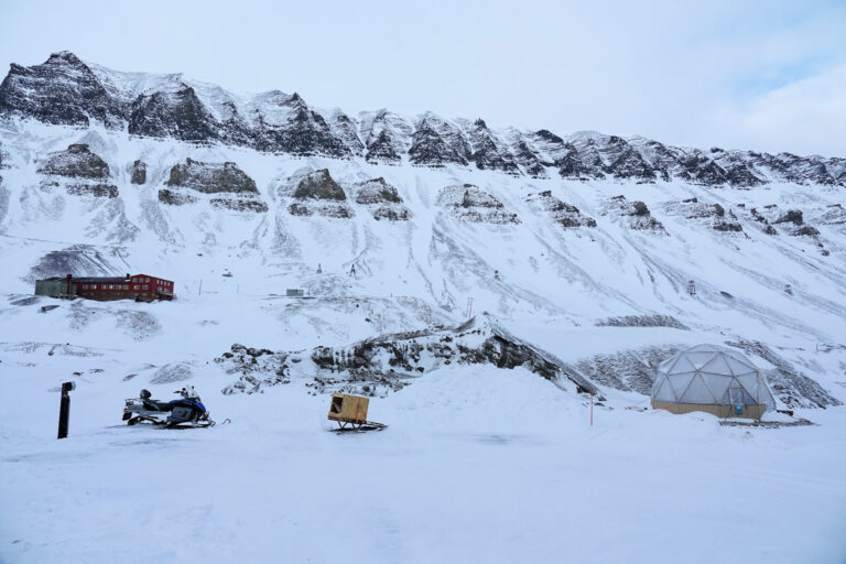 Photo of the only farm (the geodesic dome) growing edible food in Svalbard, Norway.