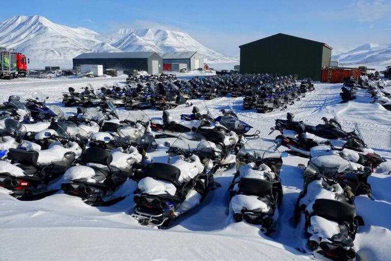 Photo of snowmobile cemetery in Longyearbyen, Svalbard.