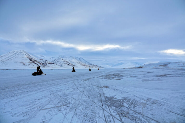 Photo of snowmobiles leaving Longyearbyen, Svalbard, to go on new adventures.