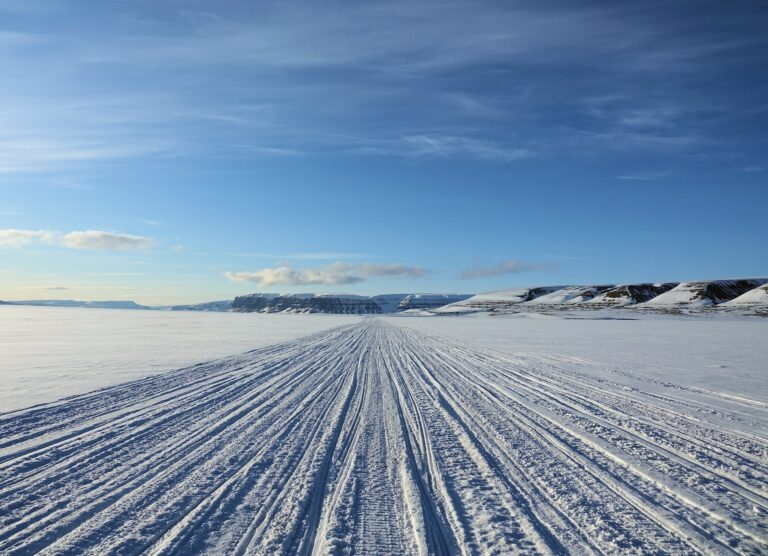 Photo of tracks on the snowmobile highway across Sassendalen, Svalbard.