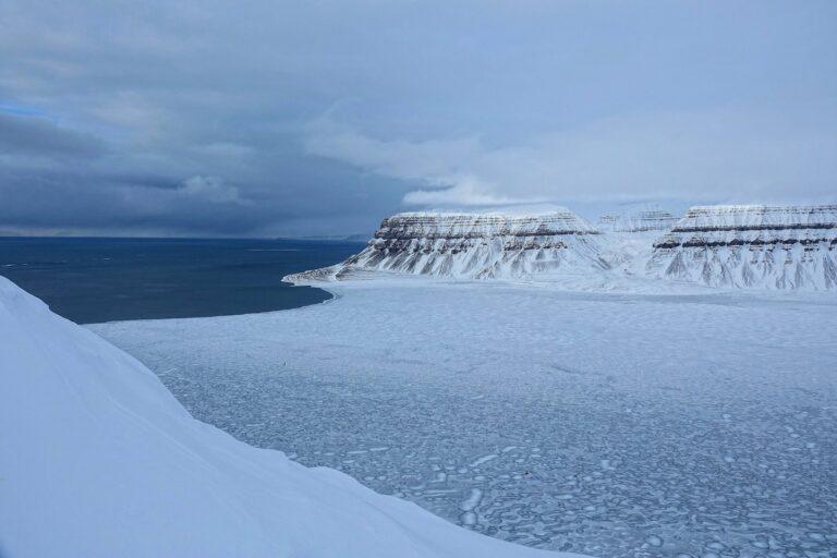 Photo of half-frozen Tempelfjorden on Svalbard, Norway, seen from Fjordnibba lookout.
