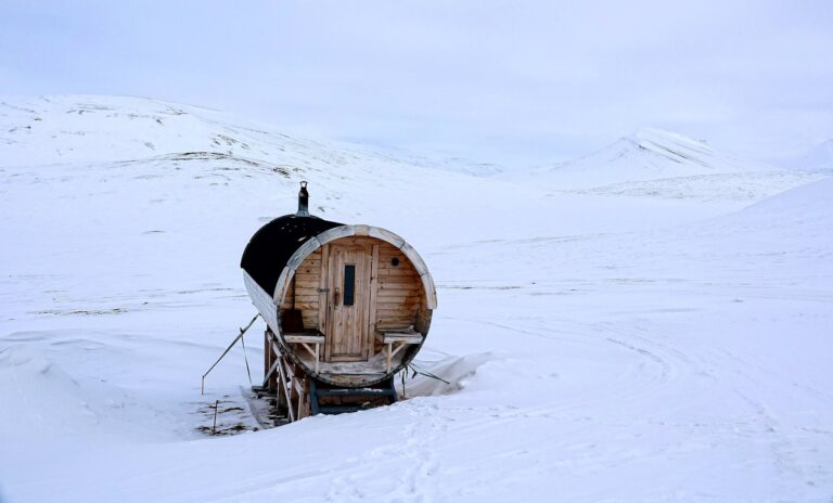 Photo of a Hobbit home in the Arctic, or maybe just a sauna on an island with no trees.