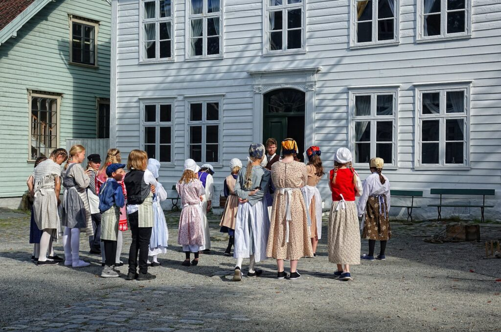 Photo of children acting as if they lived in the 19th century in Bergen, Norway.