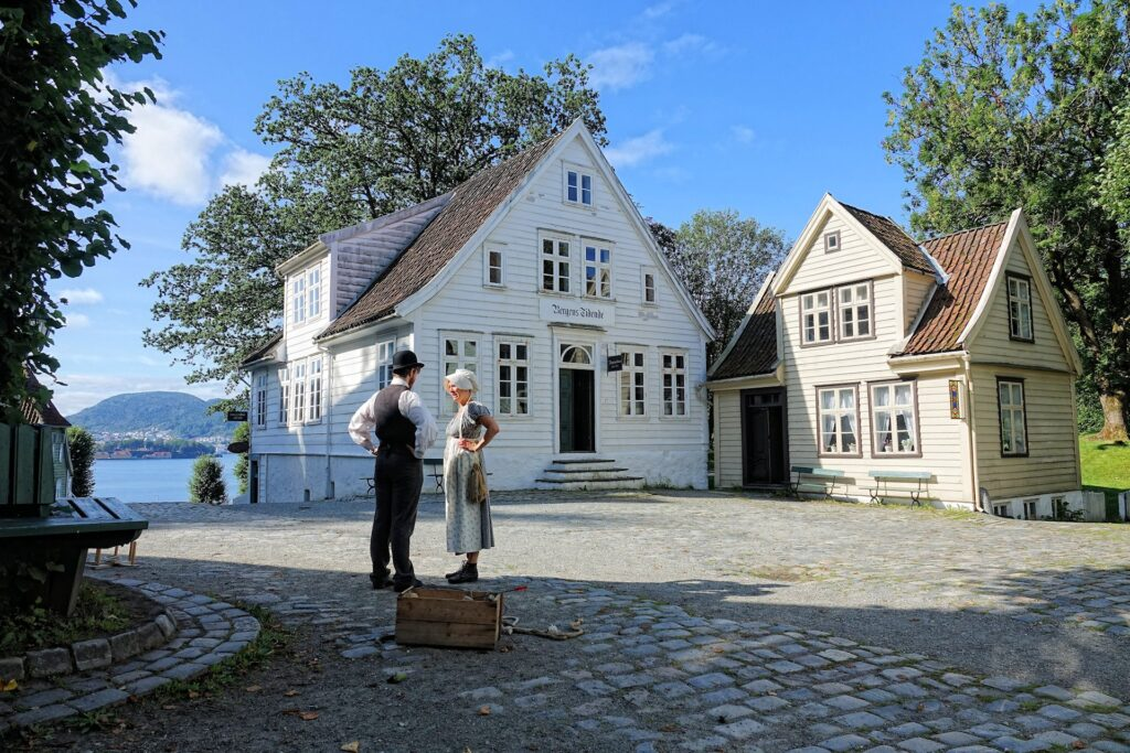 Photo of man and woman discussing matters at the Old Bergen Museum in Bergen, Norway.