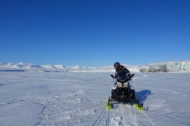 Photo of woman on snowmobile in Mohnbukta, Svalbard.