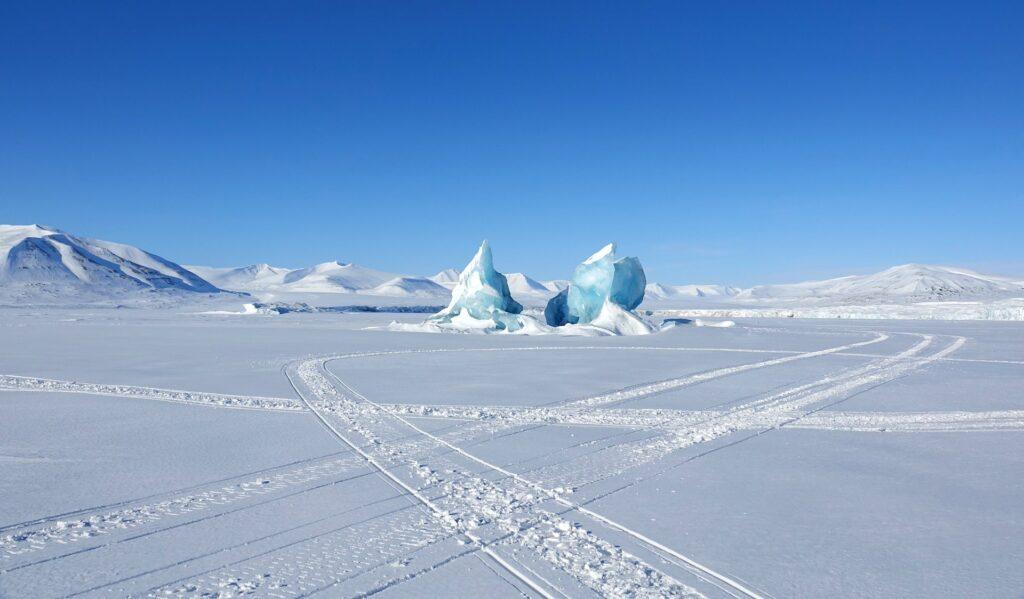 Photo of icebergs stuck in the sea ice in Mohnbukta, Svalbard.